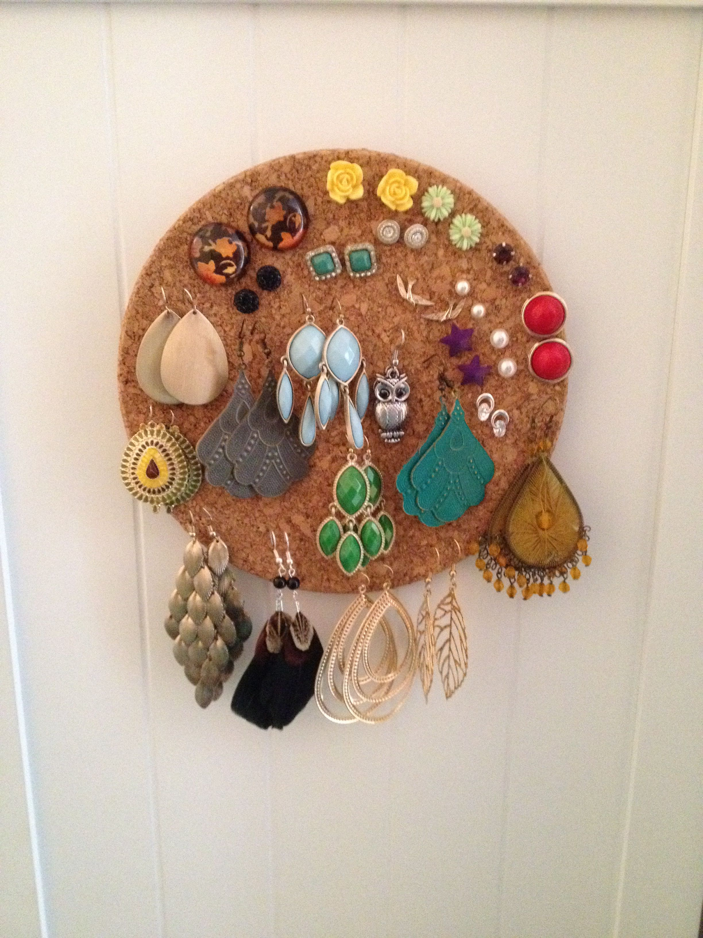 Used a cork hot pad from ikea to hold and display all my earrings Attached it to the side of my bathroom cabinet Helps me remember all the earrings I have