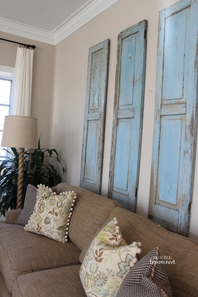 7 Inspiring Ways To Use Vintage Shutters On Your Walls Brown Living Room Decor Brown Living Room Brown And Blue Living Room