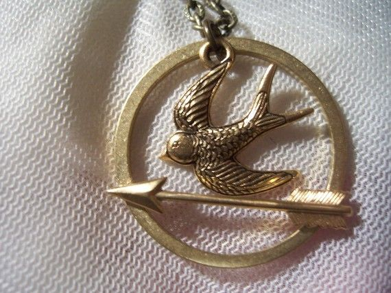 a mockingjay necklace! i MUST have this! i love the hunger games!