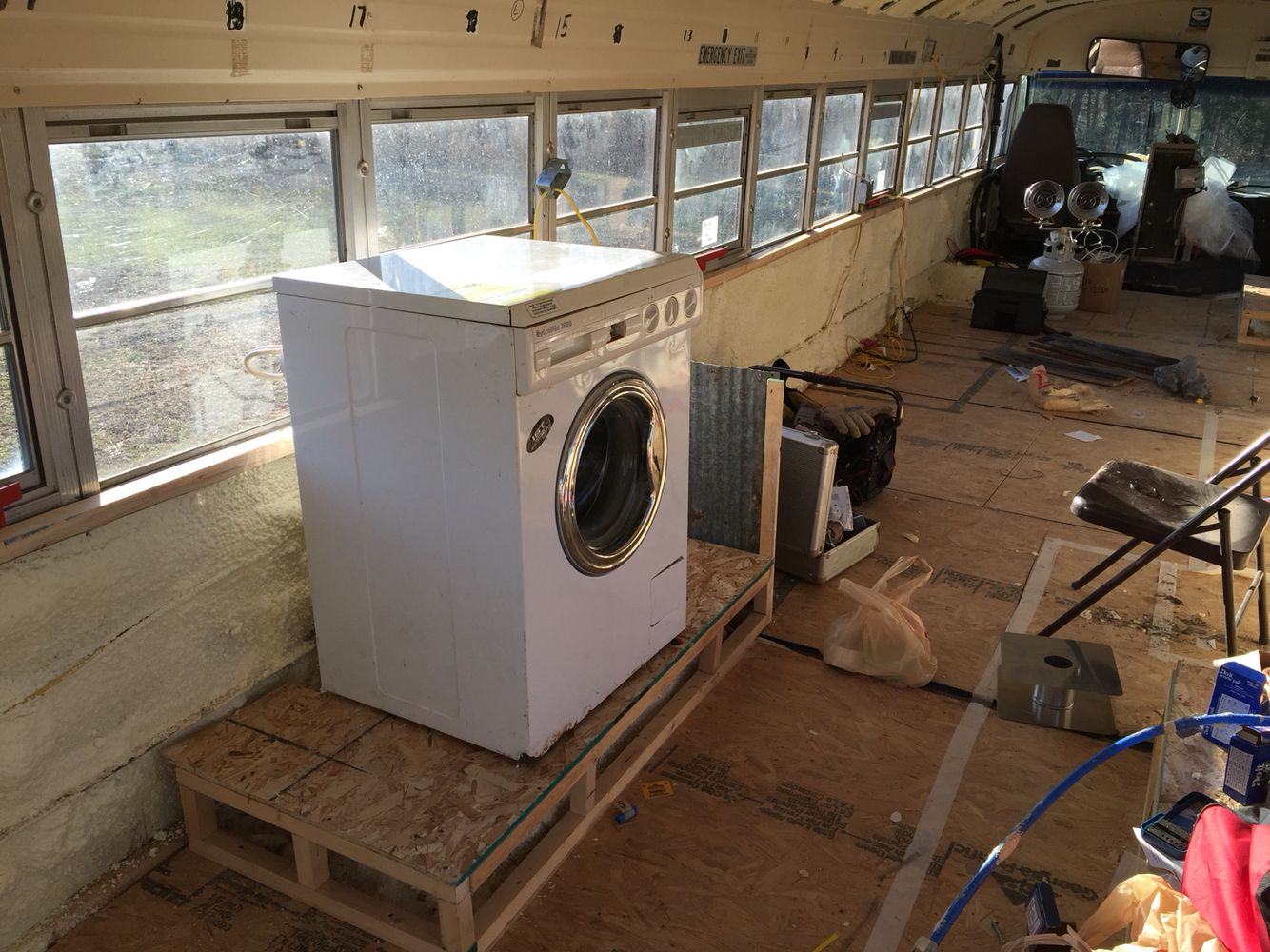 RV washerdryer installed tiny house school bus conversion