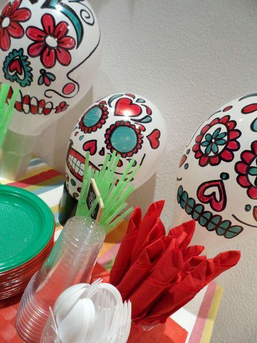 Paint balloons to look like sugar skulls