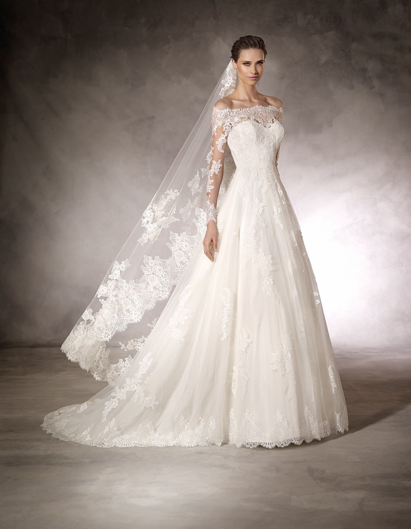 Ball gown wedding dress with sleeves  Kasumi  Pronovias  Soft lace ball gown wedding dress with