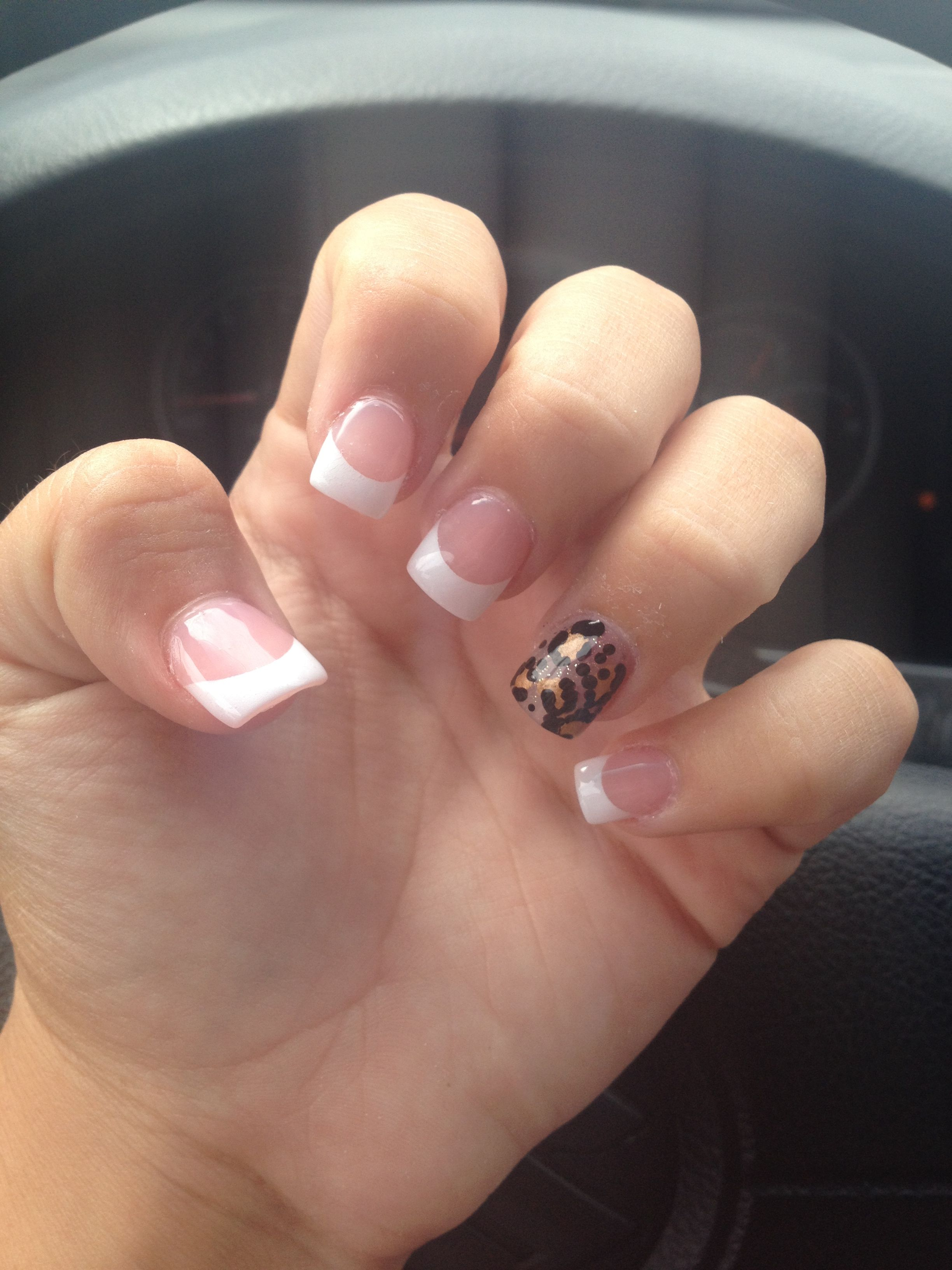French Tips With A Cheetah Design On The Ring Finger Nails