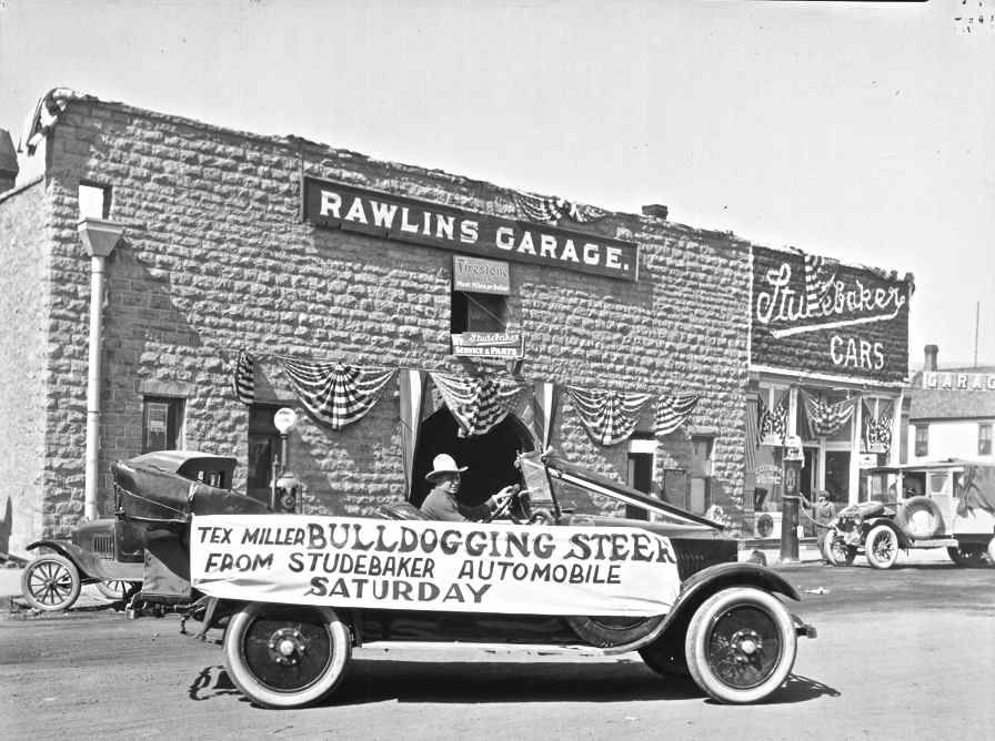 Gus Fleischler in a Studebaker in front of the Rawlins