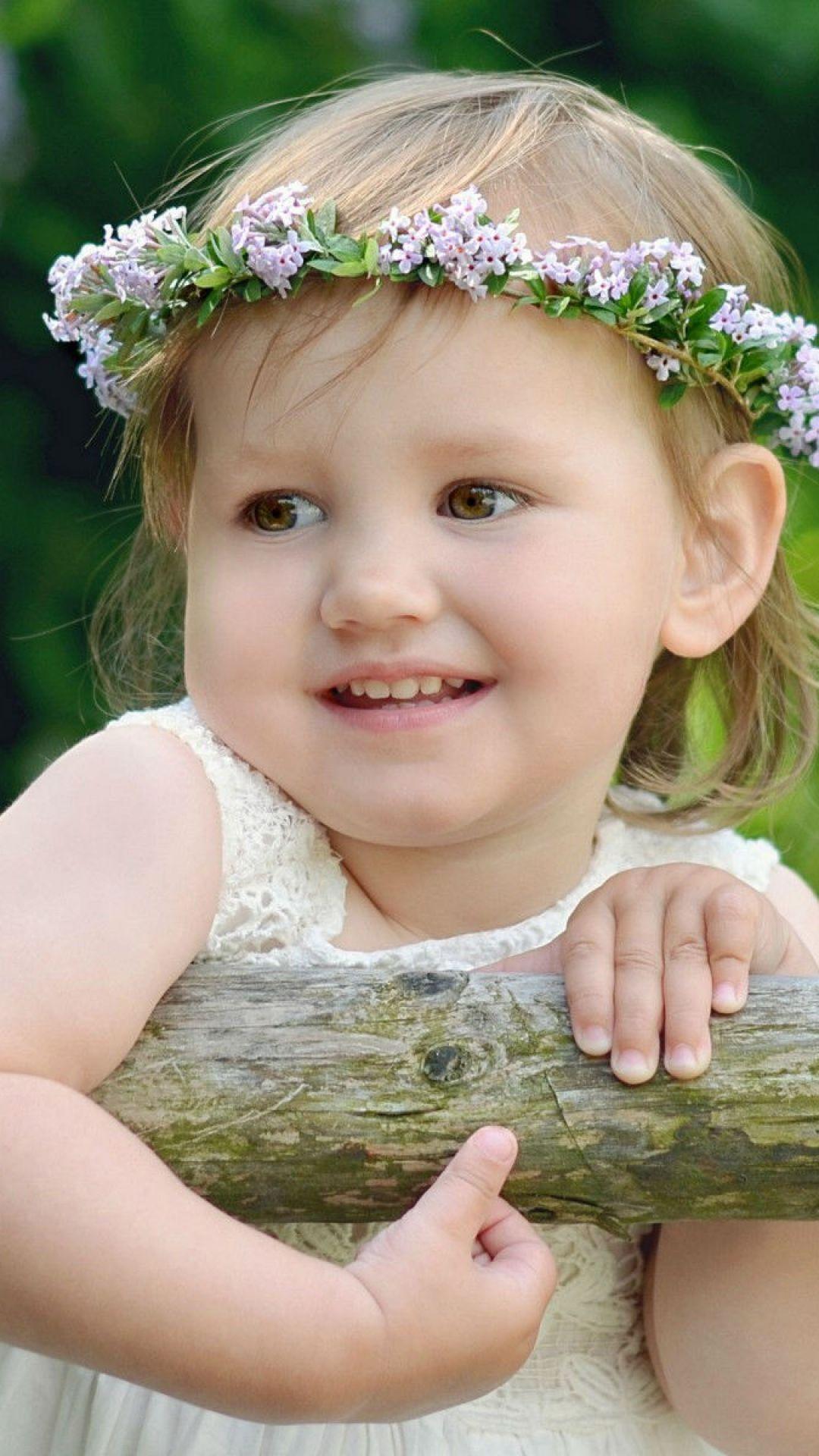 1080x1920 wallpaper child, girl, wreath, summer, smile faces1080x1920 wallpaper child, girl, wreath, summer, smile