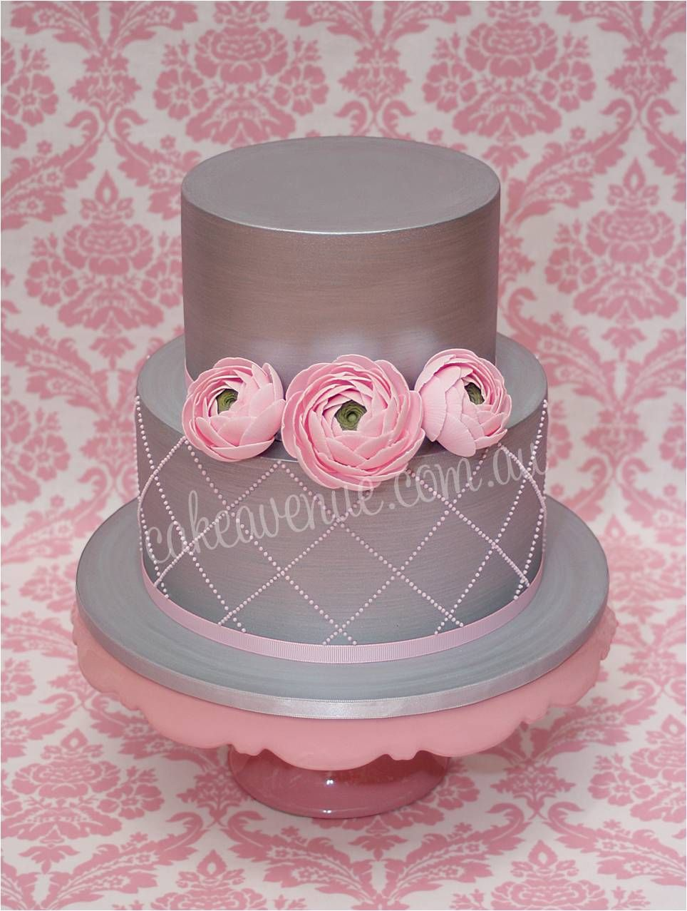 Platinum grey wedding cake with quilting and sugar ranunculus