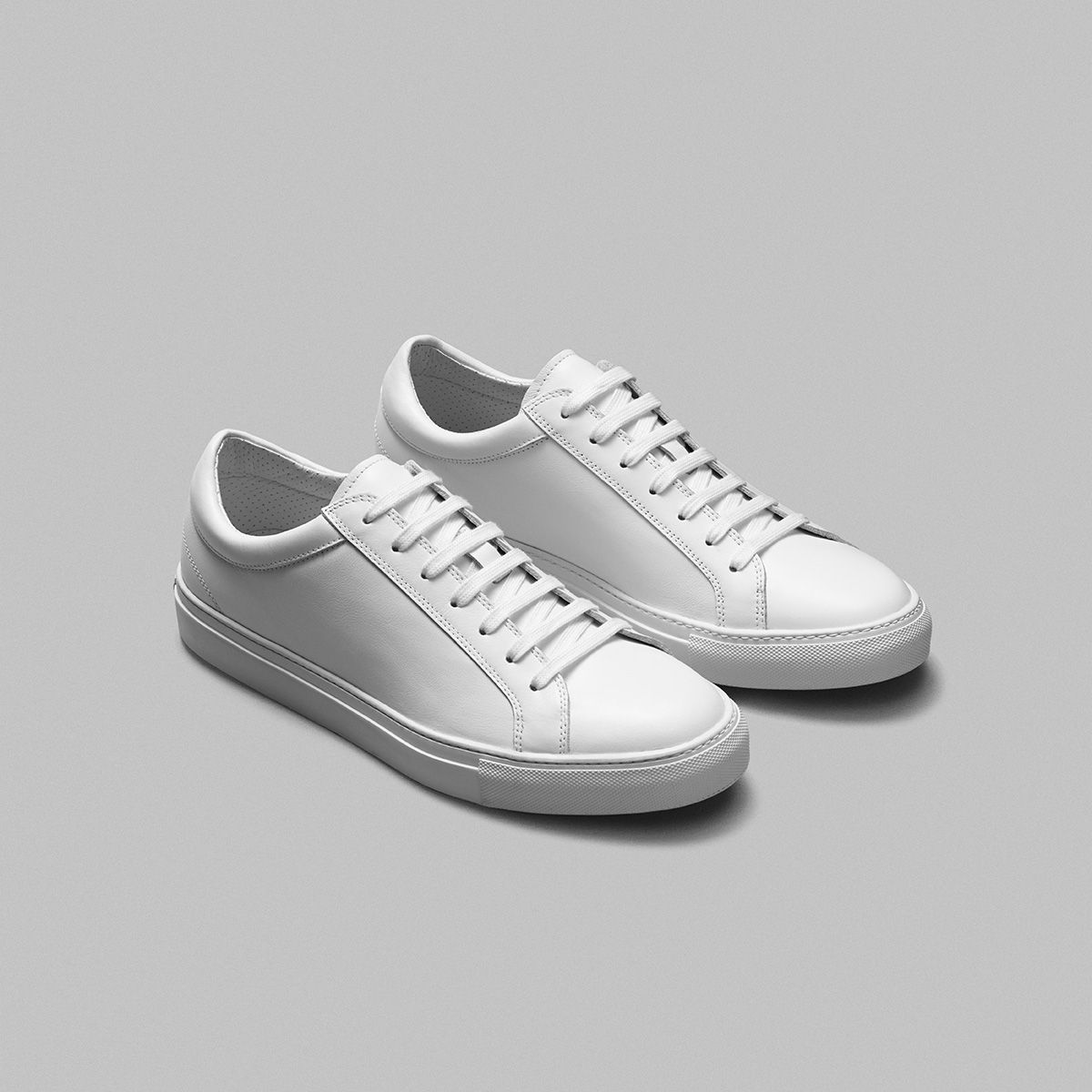 09f6dc7054a White Leather Sneaker 100% calf leather with a perforated leather lining  and a stitched on rubber sole. No logos or labels. Made in Italy.