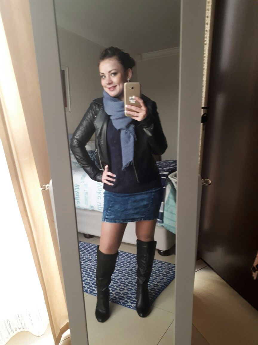 Denim dress with black leather jacket and knee high wedge