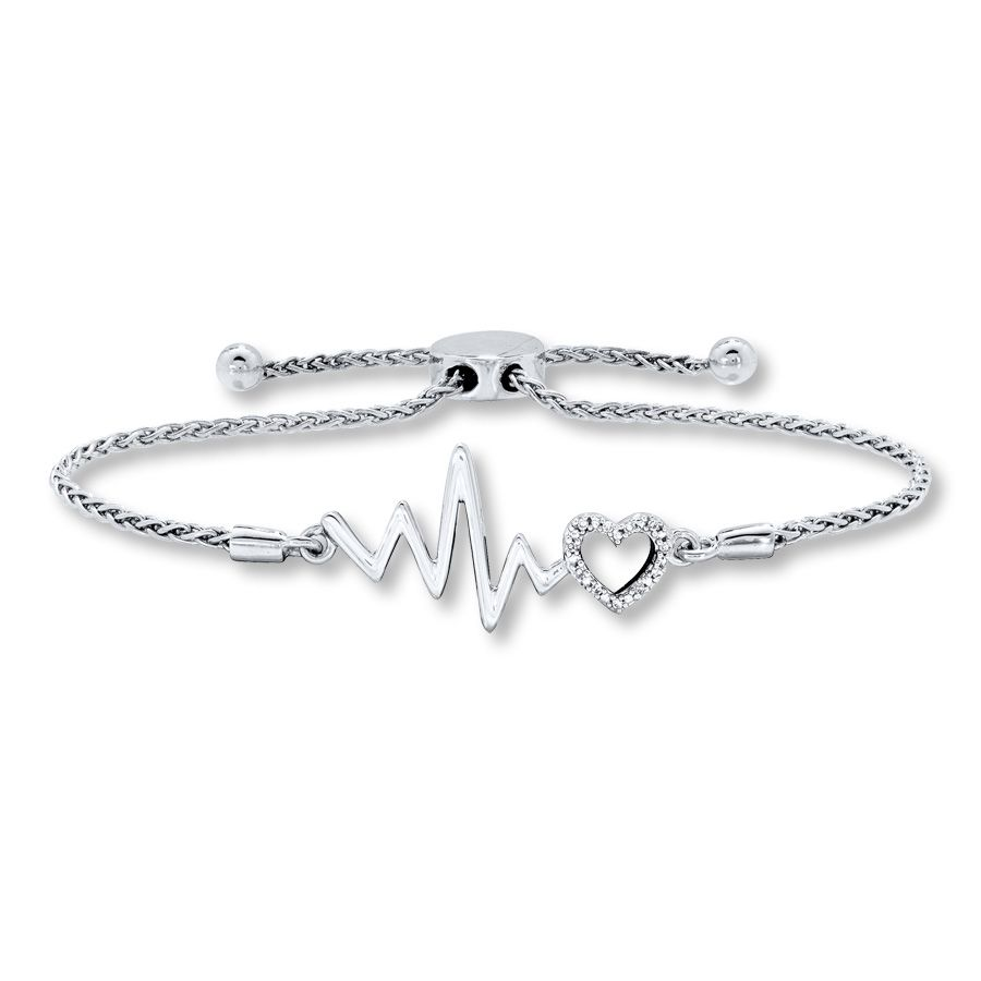 e51915157 A diamond-accented heart adds shimmer to a heartbeat design in this trendy bolo  bracelet for her, styled in sterling silver. A sliding bolo clasp on the ...