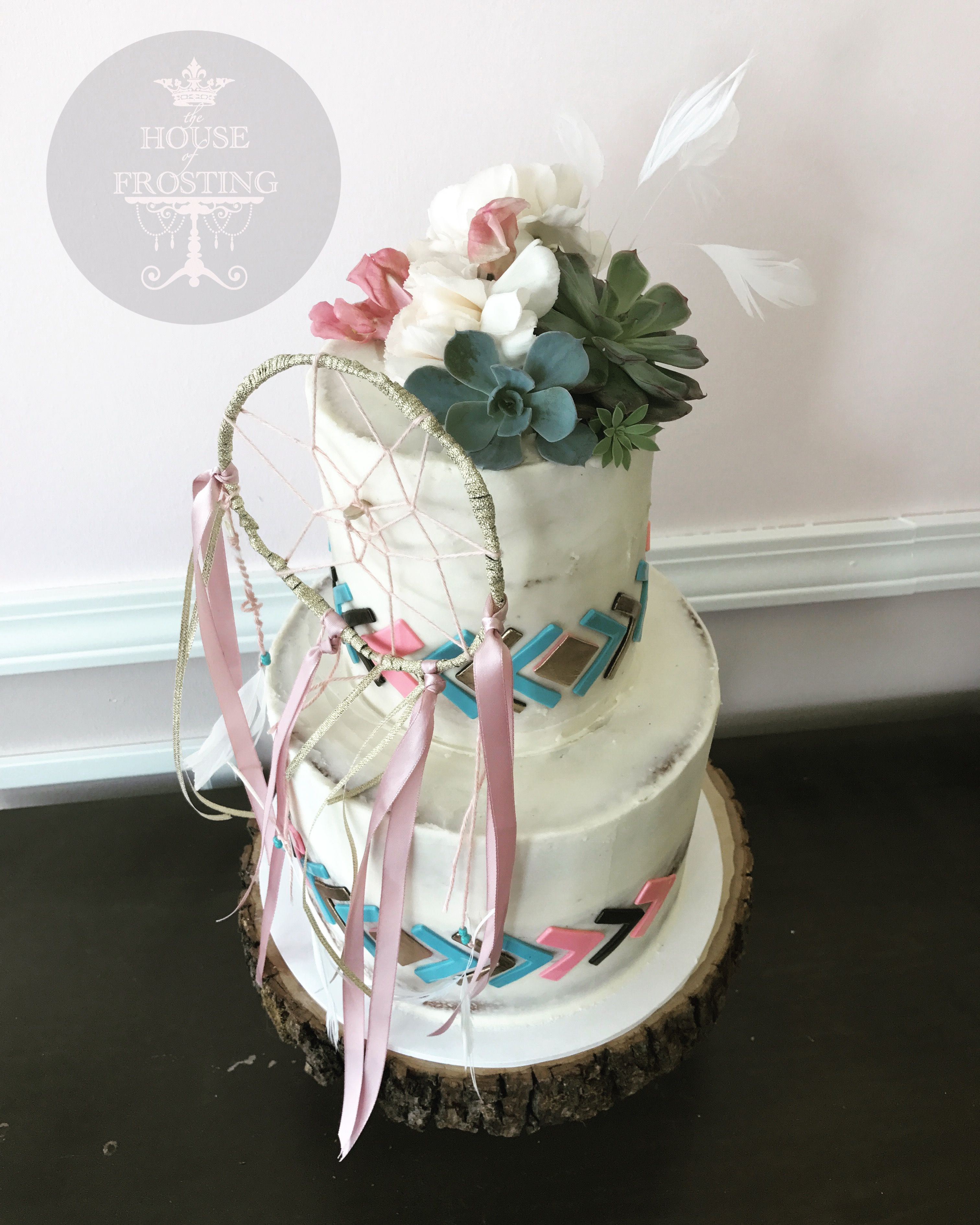 Aztec baby shower cake with dreamcatcher and succulents