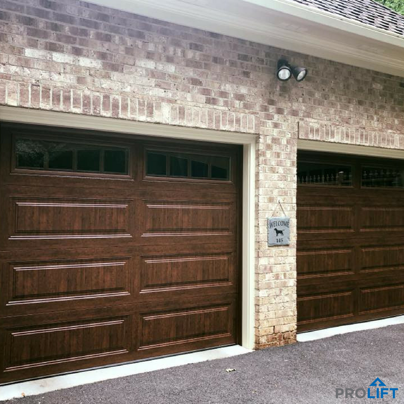 These Long Panel Steel Garage Doors Have The Ease Of A Low Maintenance Door Material With The Look Of Garage Door Styles Garage Door Design Garage Door Panels
