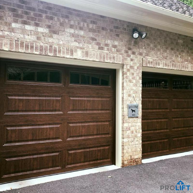 These Long Panel Steel Garage Doors Have The Ease Of A Low Maintenance Door Material With The Look Of Garage Door Styles Garage Door Design Garage Door Panels