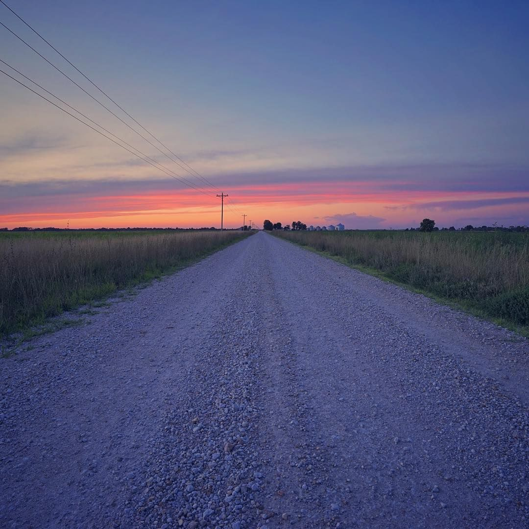 Endless road into an evening sky.