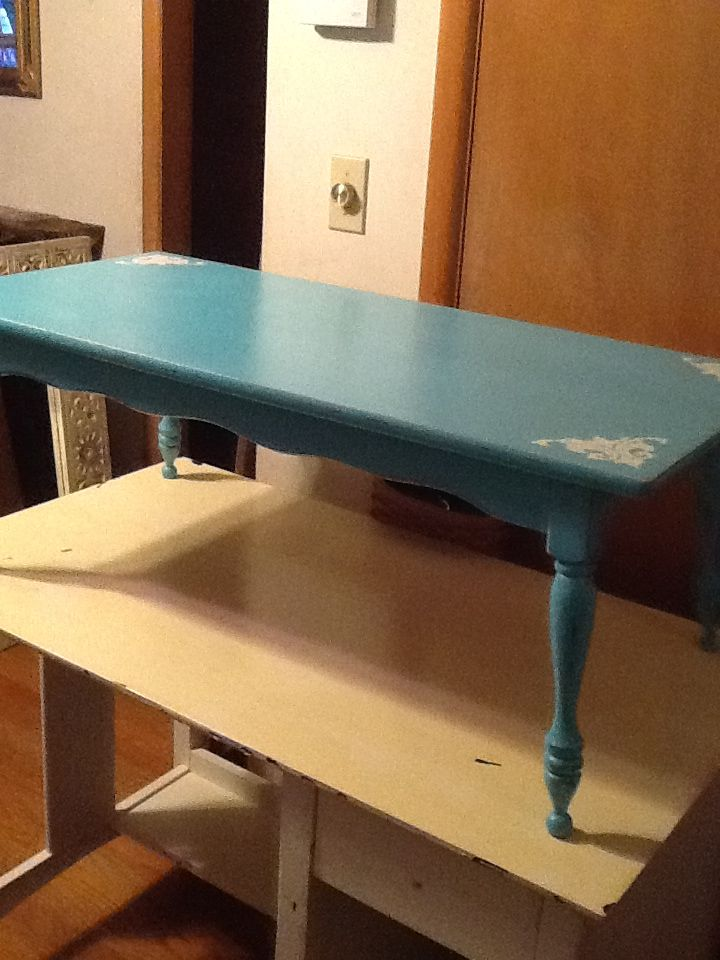 Gem turquoise coffee table. White corner stenciling.