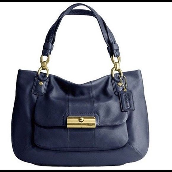 Navy leather coach handbag brand new!!! Gorgeous navy blue leather coach handbag with gold accents and light blue interior brand new with tags and dust bag Coach Bags