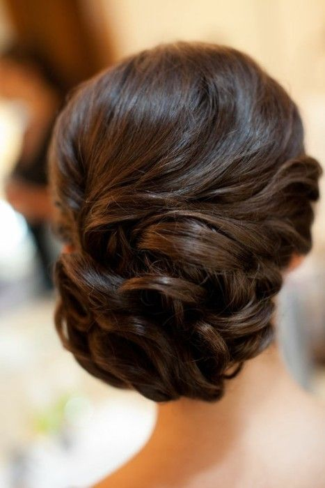 big roller set or big barreled curls, looped and gathered in back - trending currently is looping a loosened braid into a low side bun and pinning/looping/pulling to get this romantic effect.