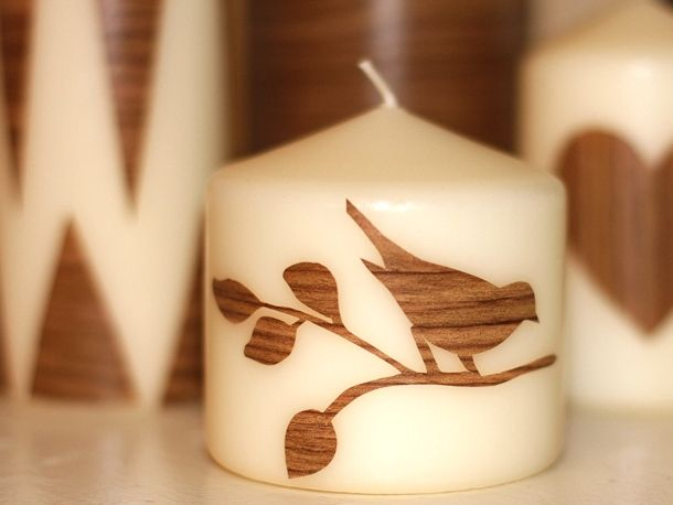 Aren't these darling? I just came across these to-die-for candles at The Divine Minimalist. Using woodgrain contact paper, an x-acto knife, and some store-bought candles.
