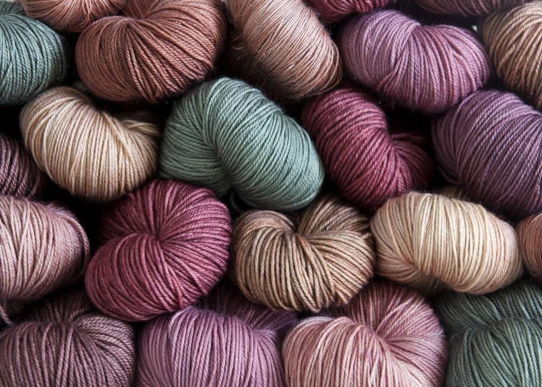 Jewel toned hand dyed yarn by blossomandfernyarnco
