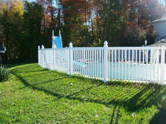 Colonial Style White Poly Vinyl Fence With Gothic Post Caps Around Pool Fence Around Pool Backyard Oasis Backyard