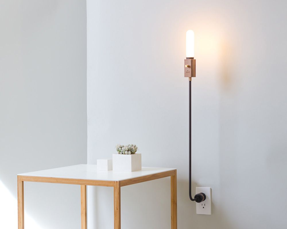 Incredibly Lightweight Wald Is A Lamp Anchored By A Wall Socket Lamp Wall Mounted Lamps Swing Arm Wall Lamps