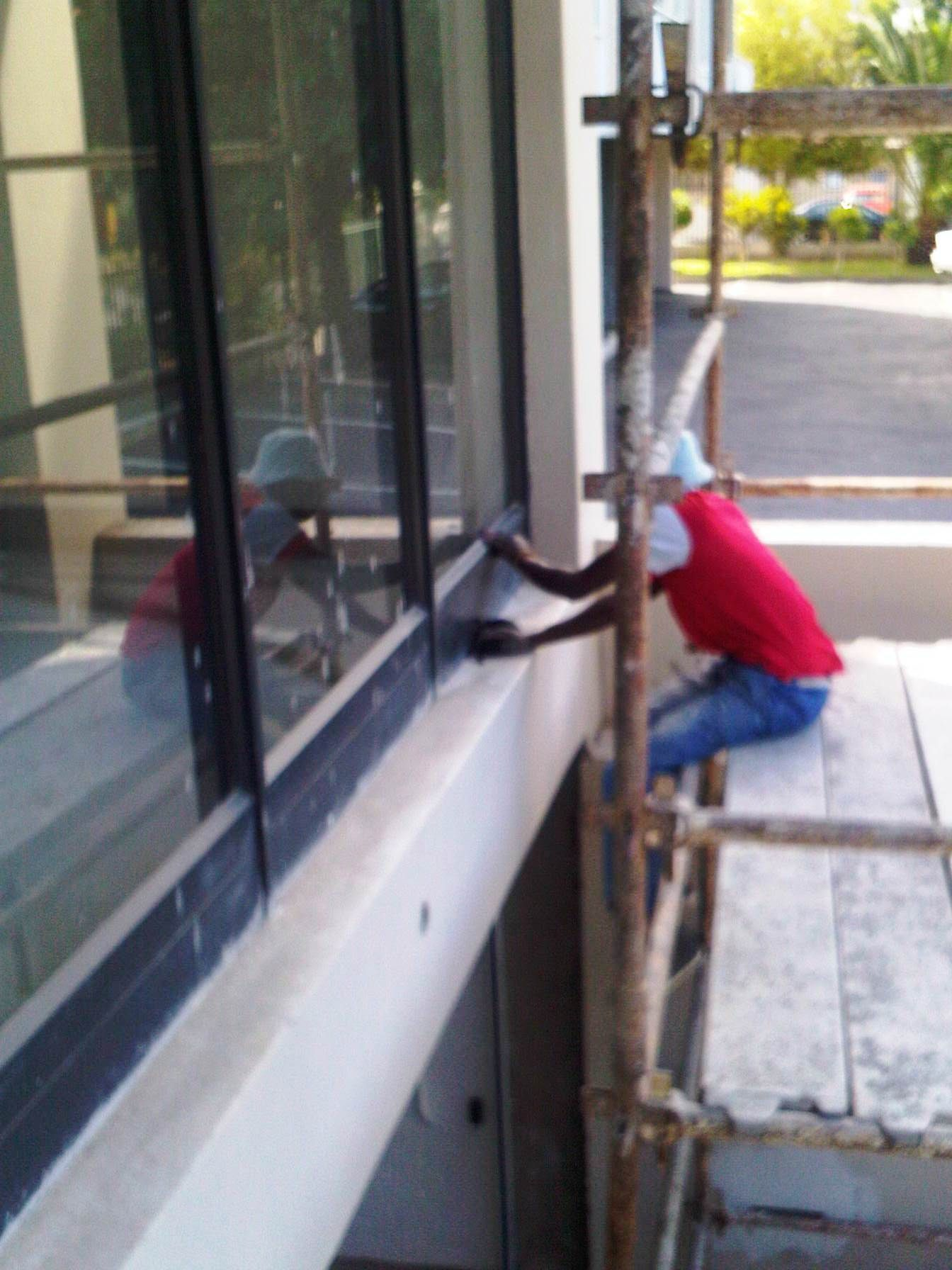 Our right hand man - Fred - resurfacing window frames at a building ...