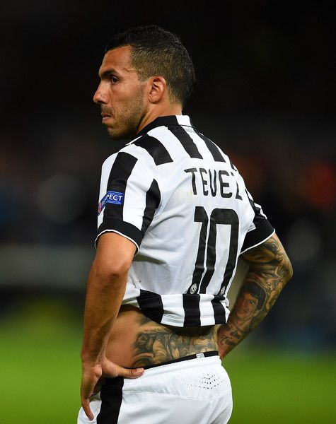 Carlos Tevez of Juventus looks dejected after the UEFA Champions League Final between Juventus and FC Barcelona at Olympiastadion on June 6, 2015 in Berlin, Germany.