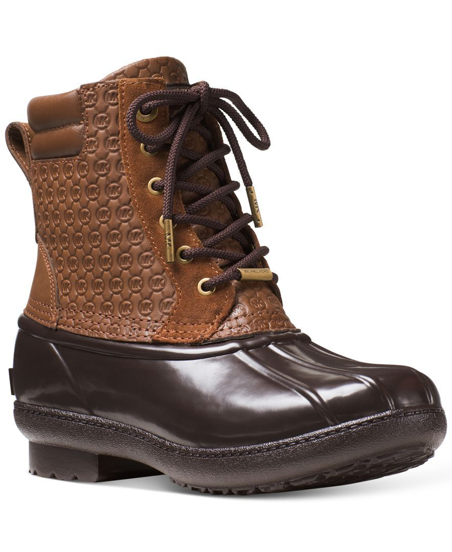 19db2d169efa Michael Michael Kors  Easton booties are a fashionable take on the foot-friendly  duck boot. Signature Mk embossing elevates this dependable silhouette.