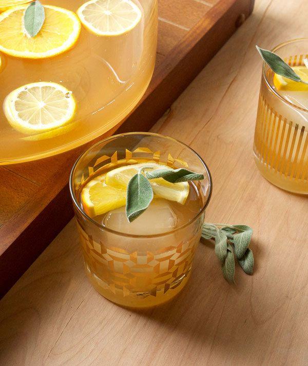 citrus sage punch served in retro glasses @myweddingdotcom