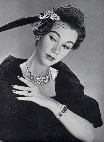 Sophie Malgat in jewelry by Chaumet and hat by Rose Valois, 1952