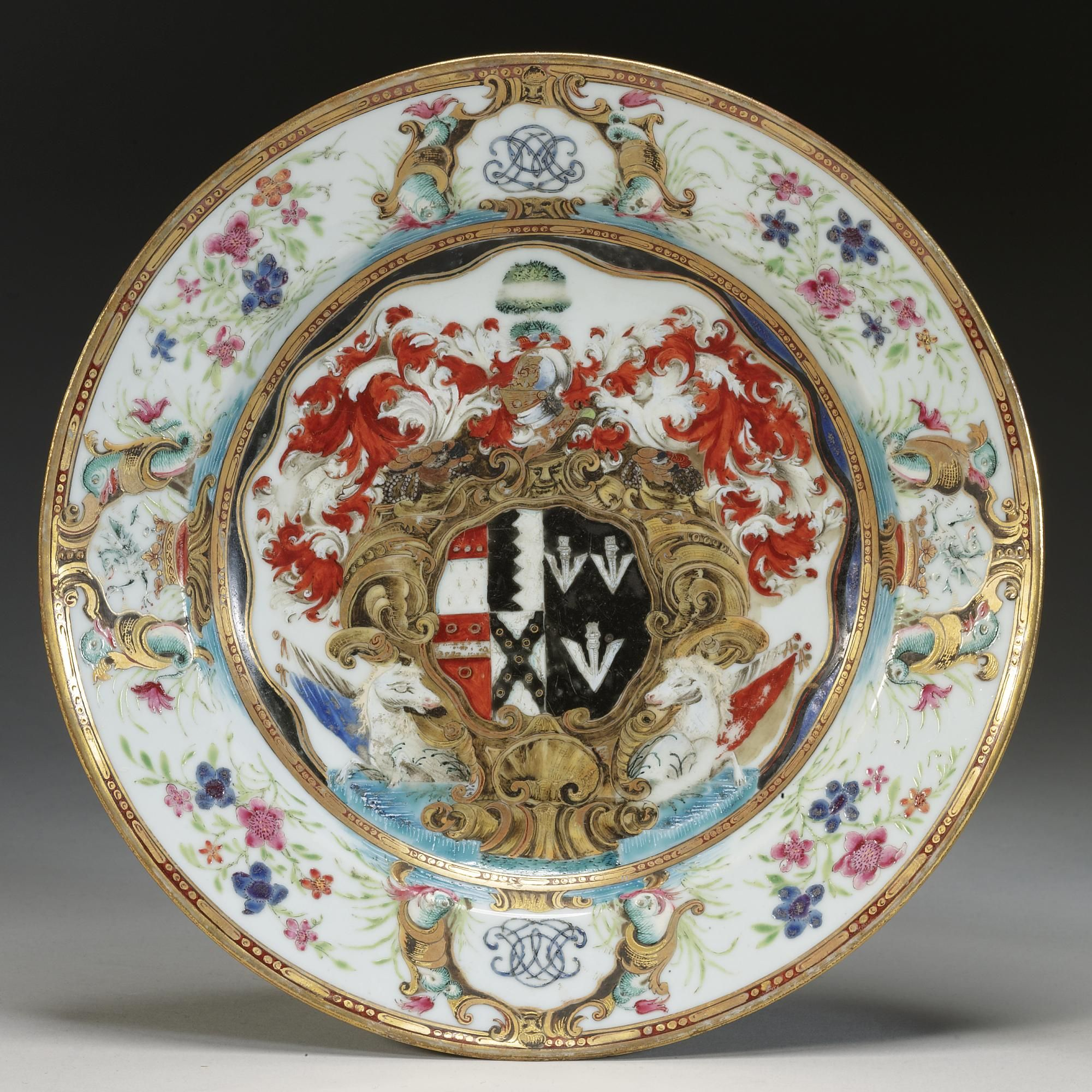 A Chinese Export Armorial Plate, Circa 1743, with the arms of Okeover quarterly impaling Nichol. diameter 9 in., 22.9 cm
