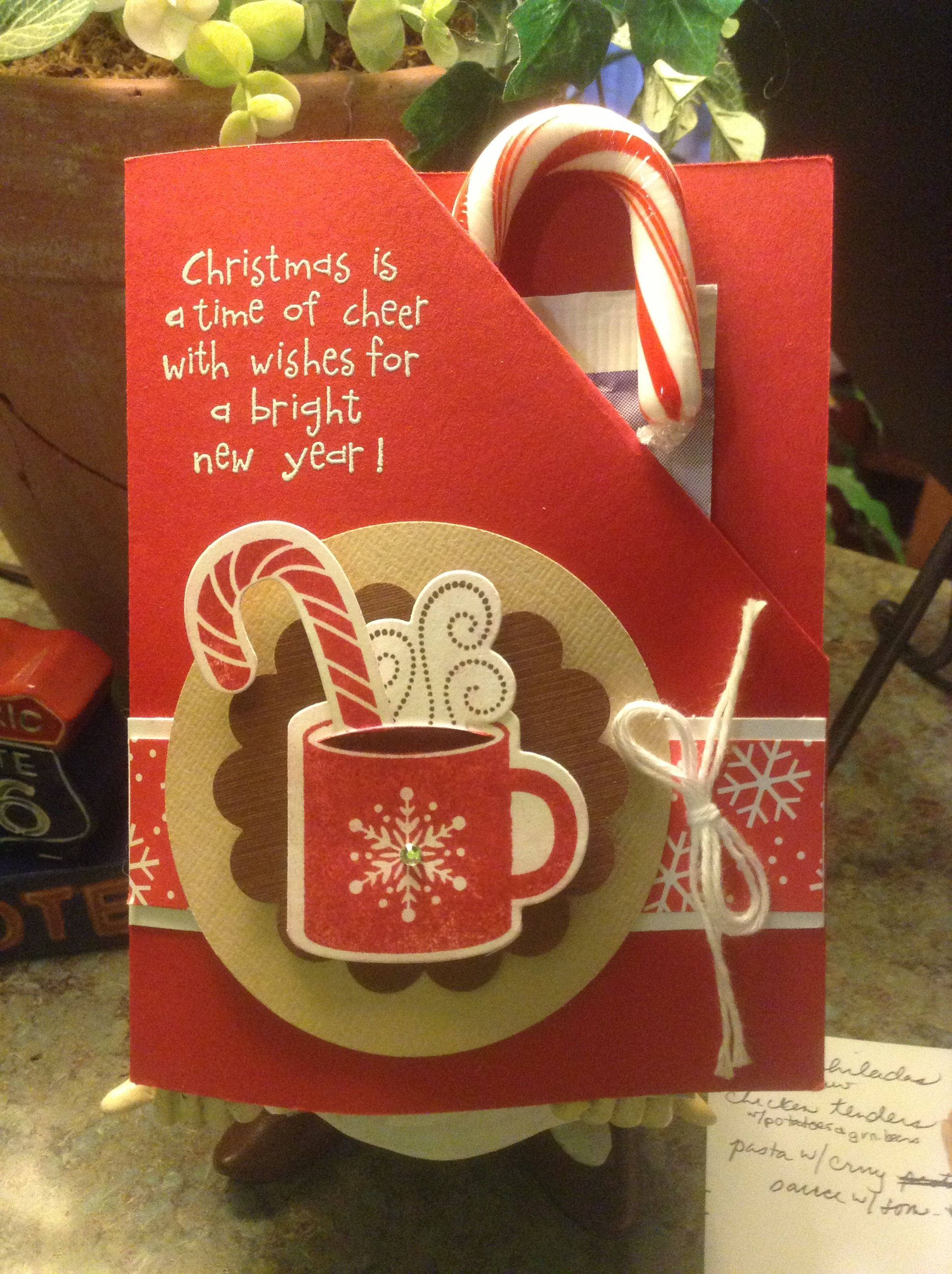 Holiday card that holds hot cocoa and