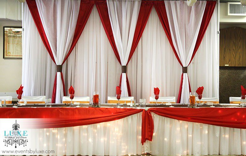 Red and white fall wedding backdrop and head table with for Backdrops decoration