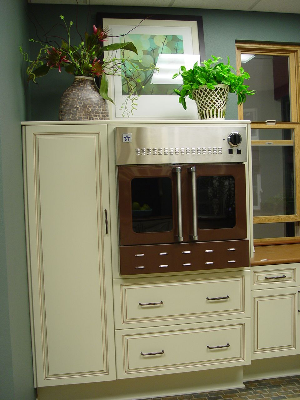 Inset ovens allow safe access. This is a Blue Star in KitchenCraft cabinetry