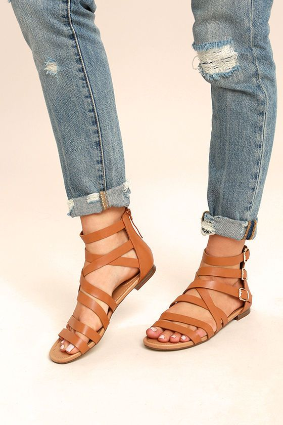 141c40b8721b Stomp through the festival fields in your new Neria Tan Gladiator Sandals!  Vegan leather straps cross over a peep-toe and climb to a cute
