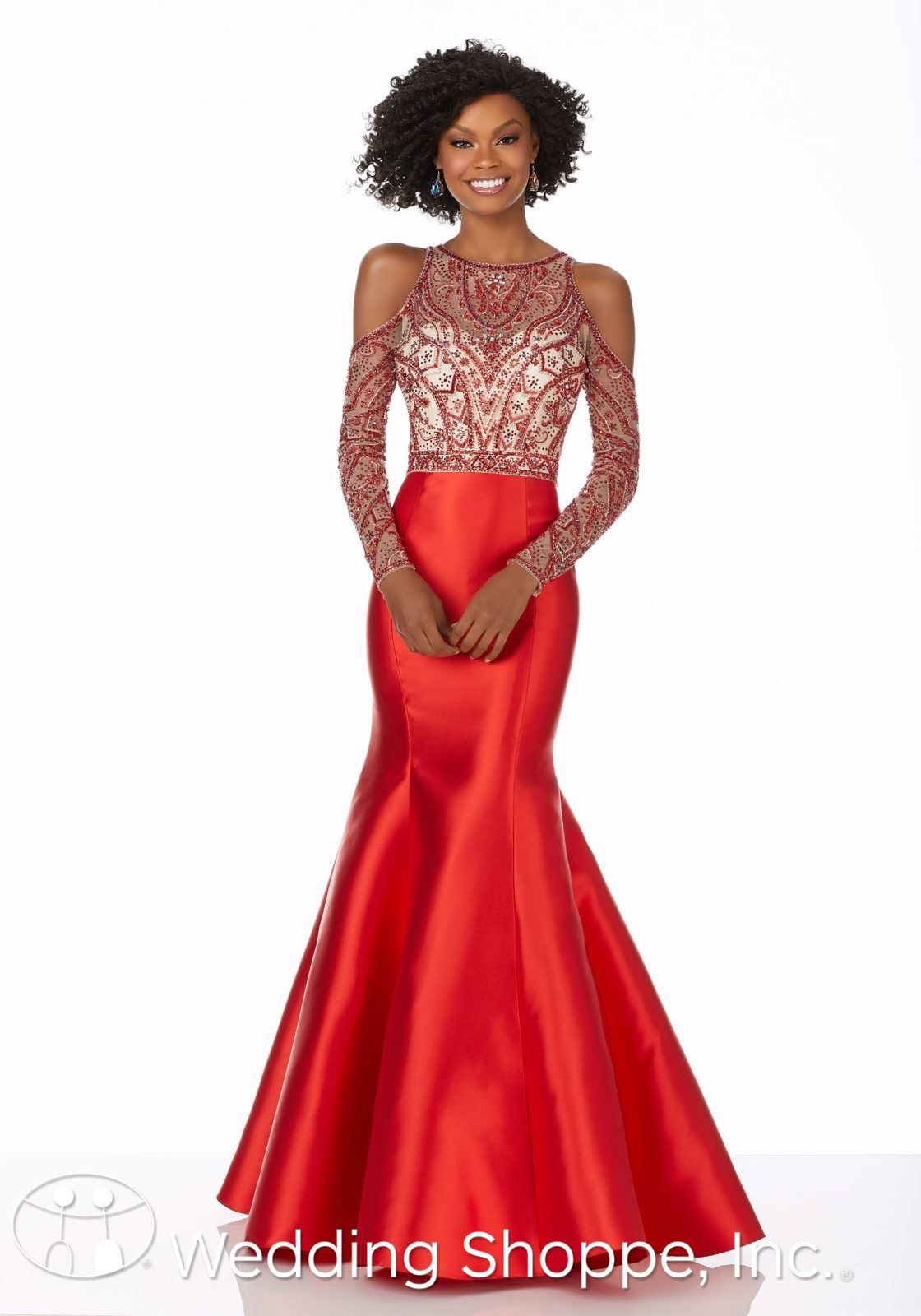 acf577c1ee This mermaid gown features a stunning silhouette with a cold shoulder  bodice