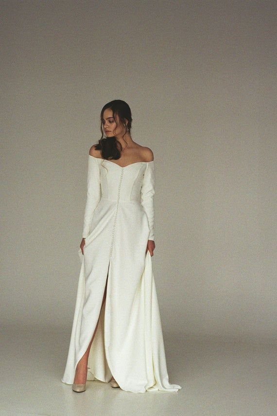 Modern off-shoulder wedding dress with a split Off-the-shoulder long sleeve crepe bridal gown Minimalist button front wedding gown SERENA 1
