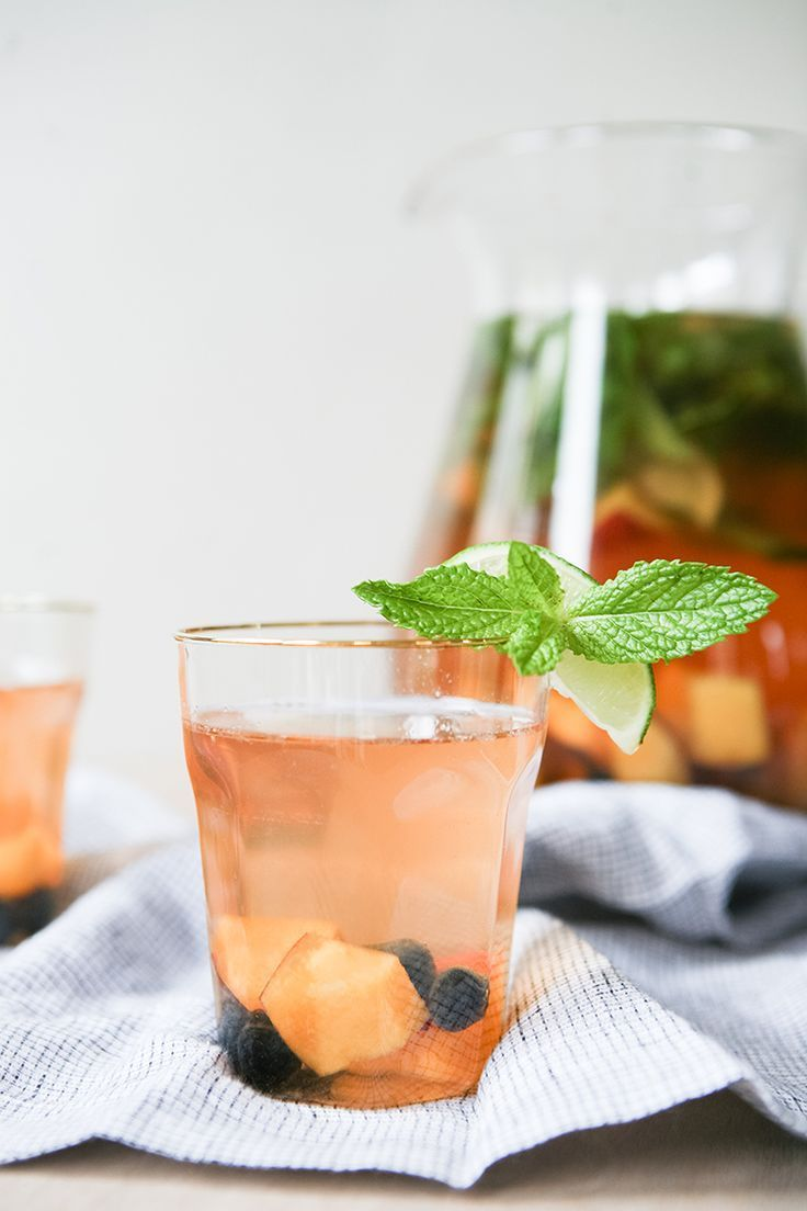This Rosé Sangria with Summer Fruits recipe is exactly what you'll want to sip all summer long: slightly tart, minty and sweet, and super refreshing. Get the full cocktail recipe on http://Jojotastic.com