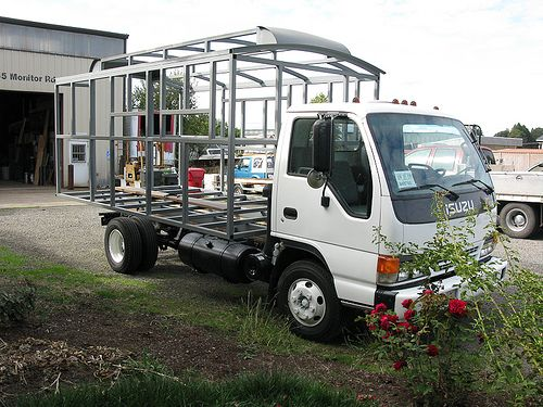 Small flat bed truck steel frame wood cabin steel cage on a f ing isuzu bus conversion - The recreational vehicle turned cabin in the woods ...