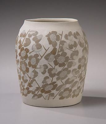 White vessel with dark brown clay inlays (neriage) of numerous plum flowers  1976-78  Stoneware with colored clay inlays (neriage)  Matsui Kôsei