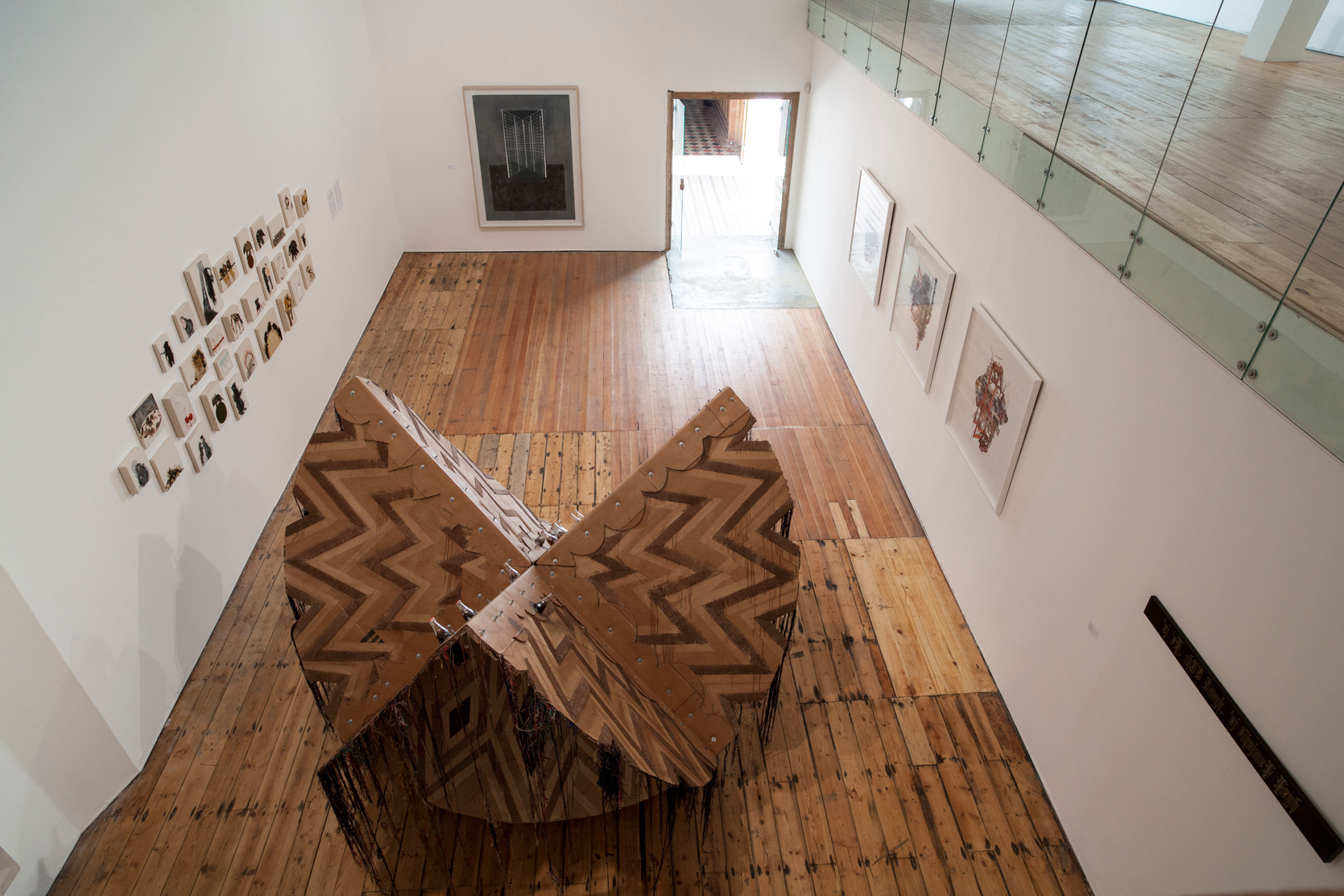 Installation view, Simeon Nelson & Moffat Takadiwa (collaboration), 'All Our Ancestors' (2014), Cardboard, bolts, thread, bottles, 260 x 260 x 200cm