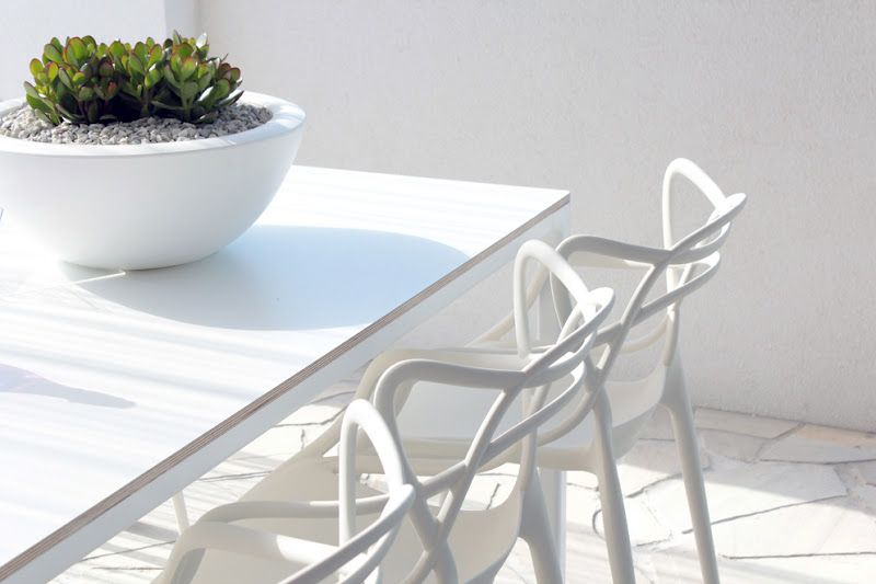 White slate terrace, Master's chairs and concrete flower pot. Perfection.