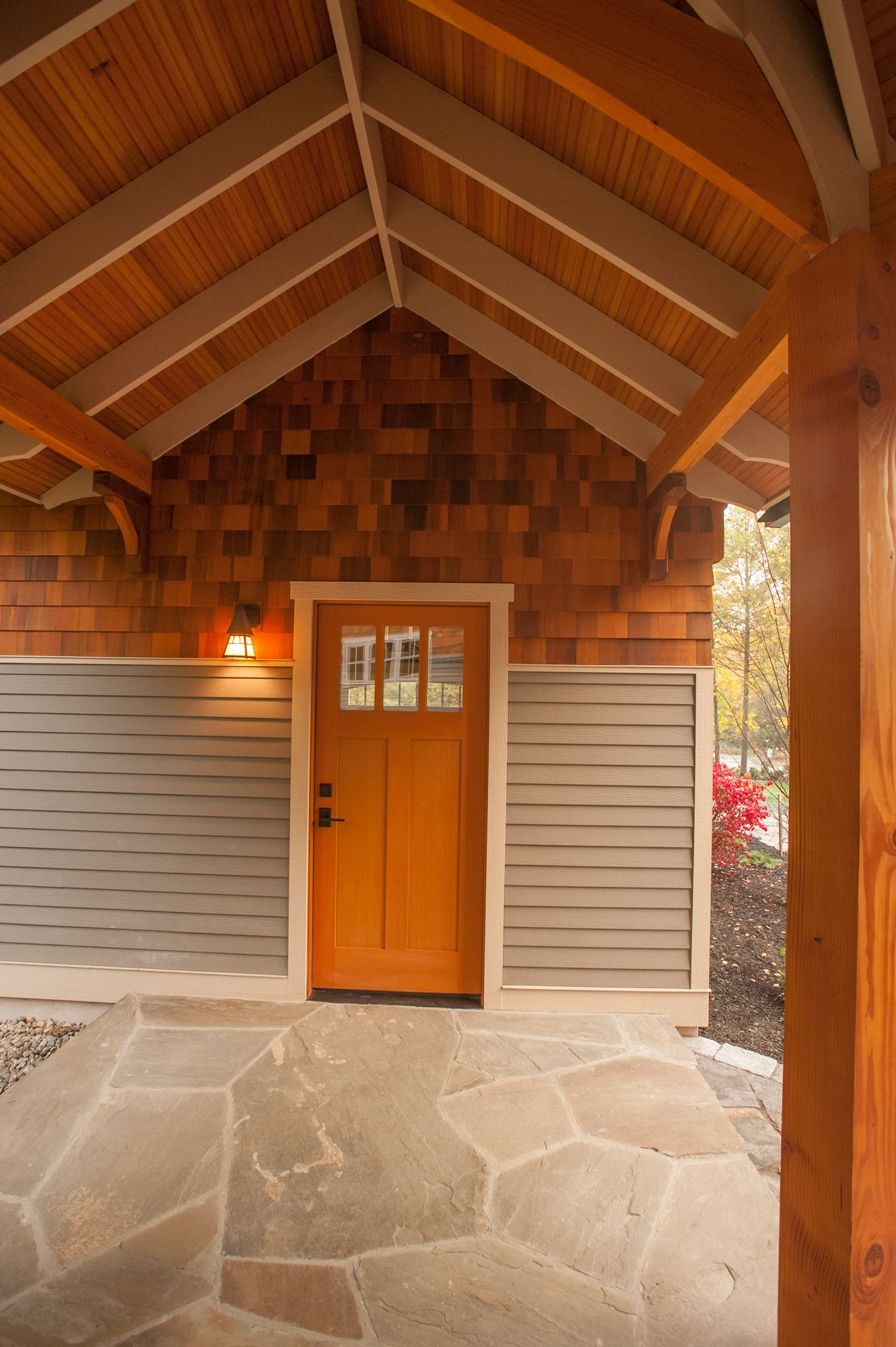 Breezeway between garage and house, wooden overhead