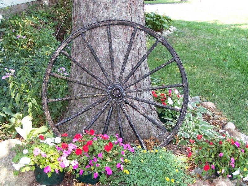 Old Wagon Wheel In Garden