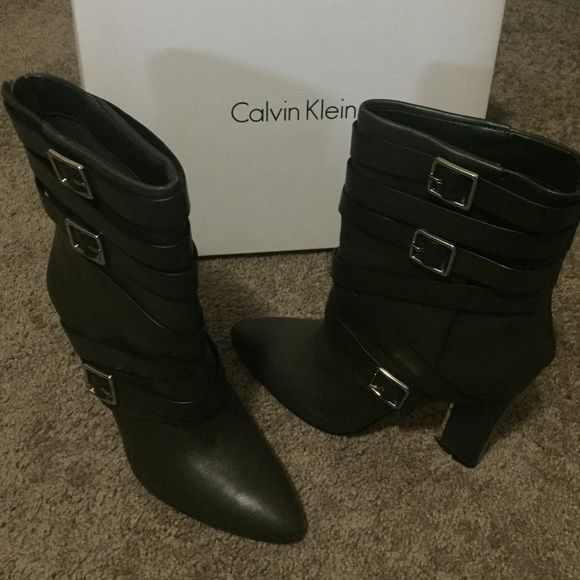 Sassy Olive Green boots. Excellent Condition !! Olive green and silver buckles and zippers. Calf boot Calvin Klein Shoes Heeled Boots