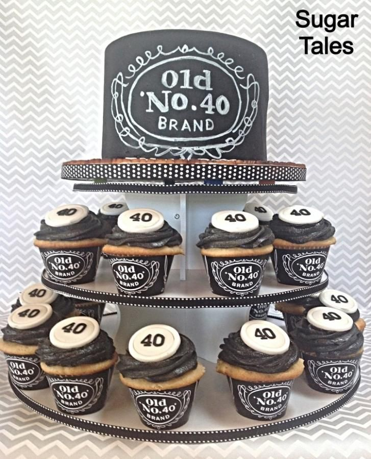 Jack Daniels inspired cake and cupcakes. Wrappers from EZ