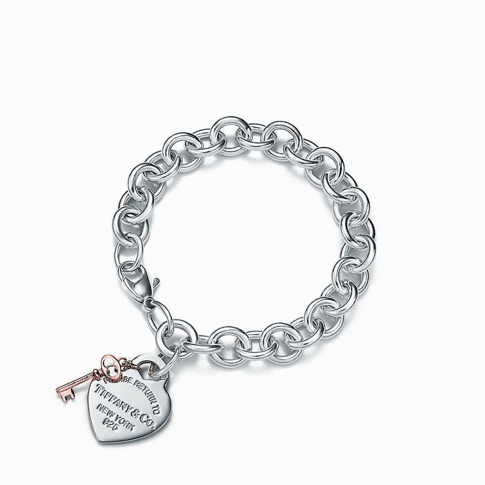 Return to Tiffany® double chain heart tag bracelet in silver and Rubedo® metal. | Tiffany & Co.
