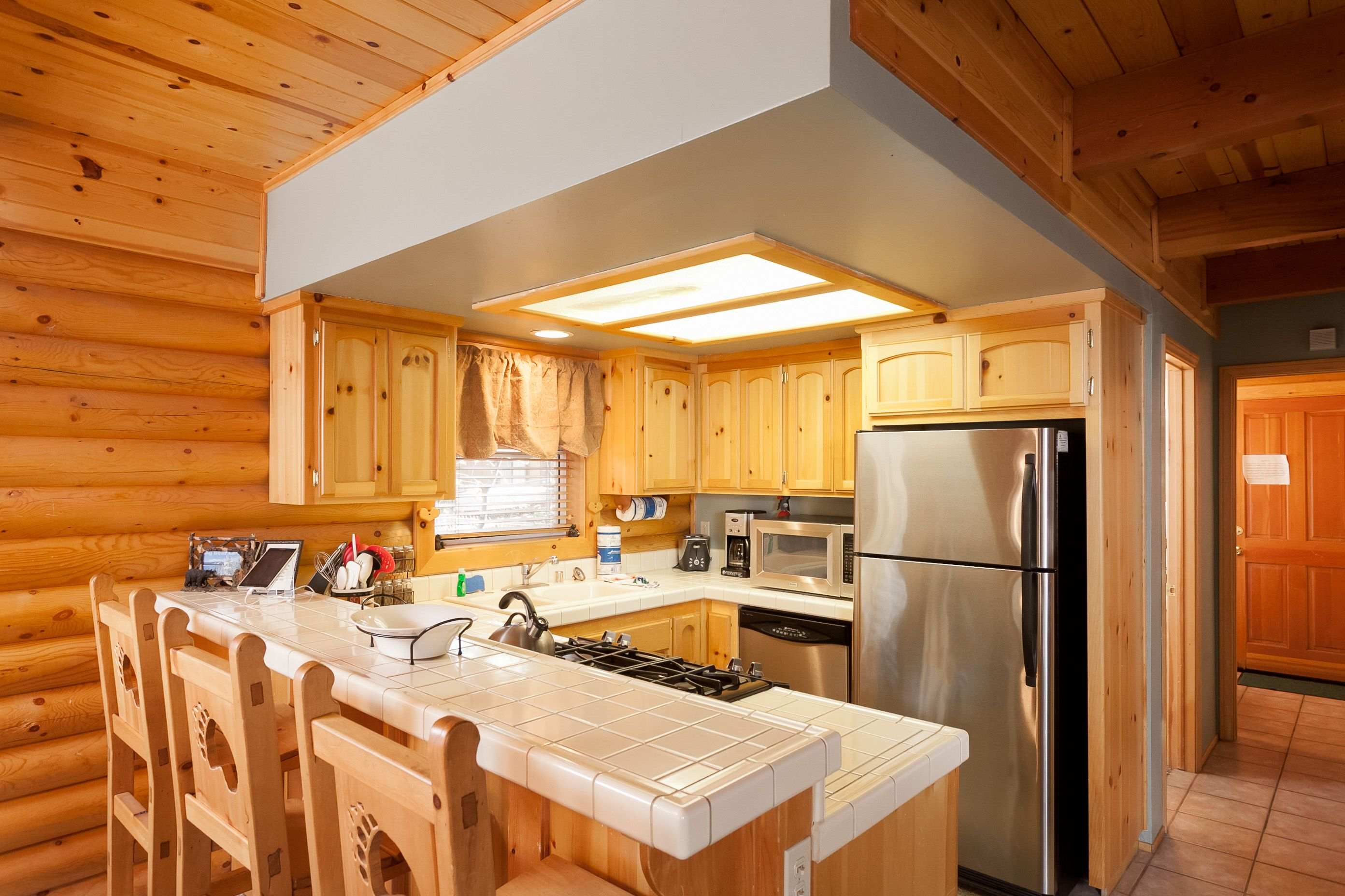 Cute Kitchen With Knotty Pine Cabinets Log Cabin Coziness In Big