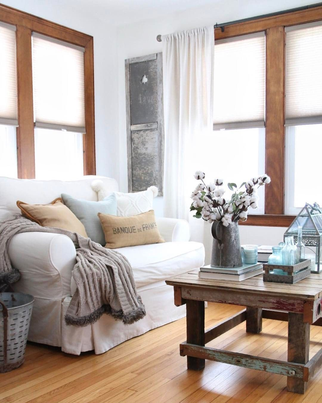 Love this cozy farmhouse living room that wood trim is
