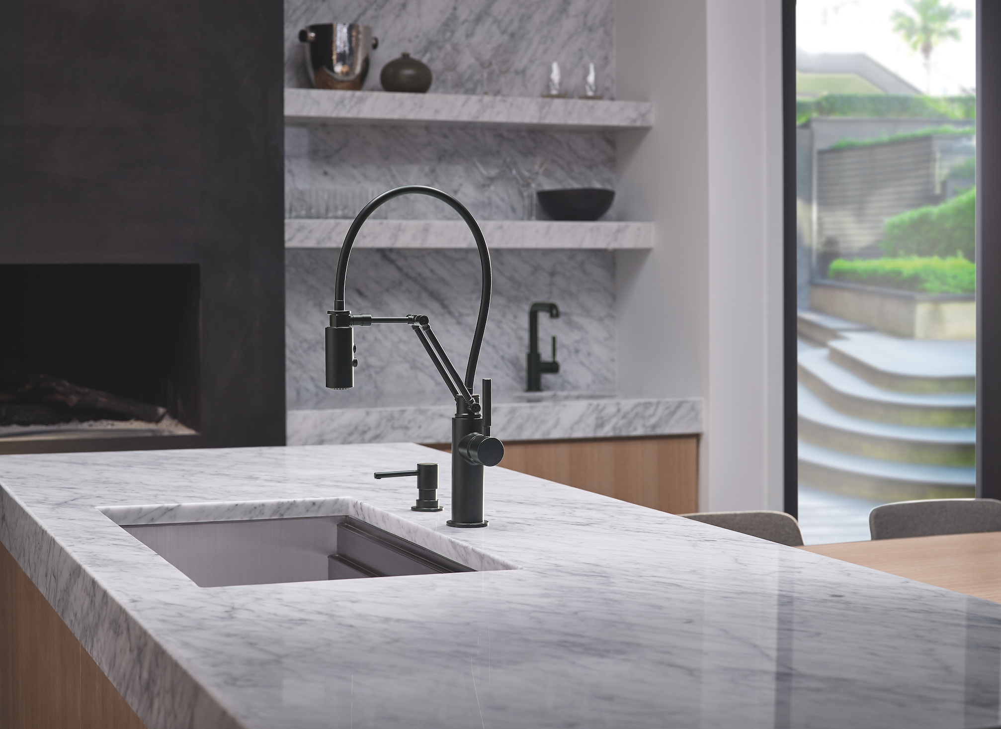 The Solna Articulating Faucet In A Matte Black Finish Space