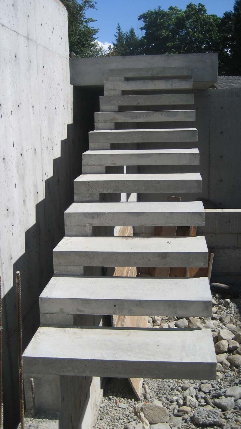 Exterior concrete cantilevered stair frontal overview for Building a concrete house